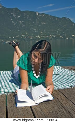 Woman At The Edge Of A Lake Lengthened