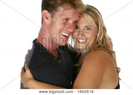 Couple In Thirties Laugh And Hug