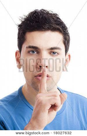 Portrait of a young man asking for silence, isolated on white background