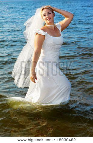 Bride Walking In Sea
