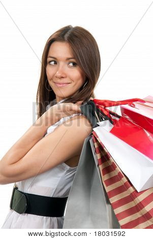 Woman Standing With Shopping Bags In Hand