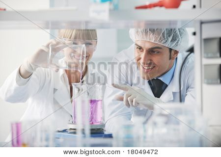 science and research biology chemistry and medicine  young people couple in bright modern  lab