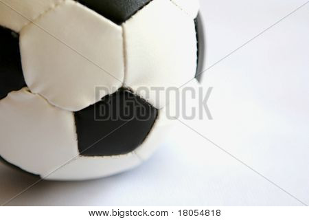 Close up of a football on white. Extremely shallow DoF.