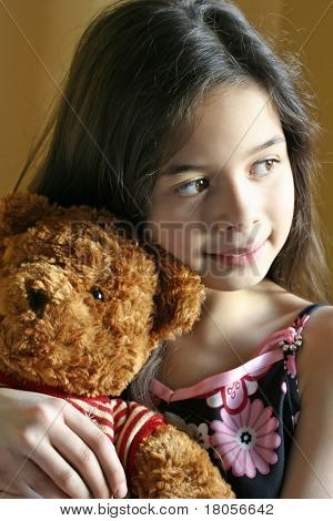 A young girl enjoying a quiet moment with her favourite cuddly toy.