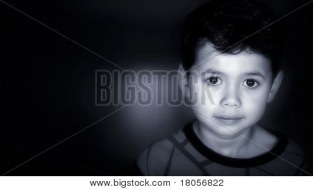 A young boy rendered tri tone of black , blue and white with copyspace