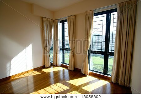 Spacious interior of a modern high rise apartment.