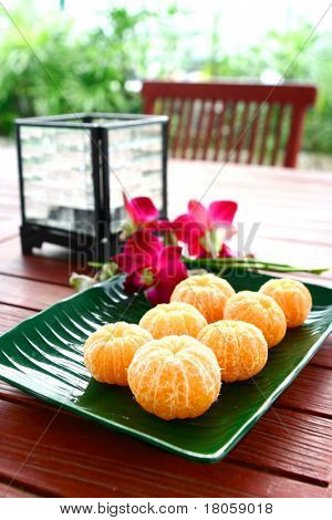A plate of peeled satsumas served in a plate