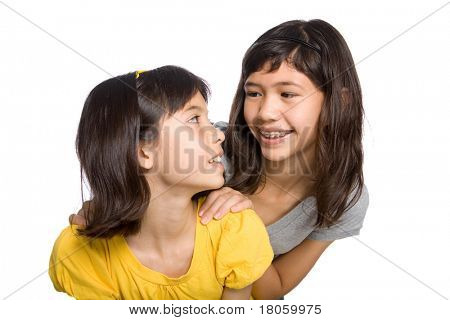 Two beautiful sisters looking at each other and having fun.