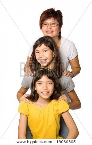 Beautiful family with two young daughters, isolated on white