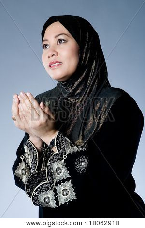 Muslim woman praying and hoping
