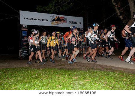SABAH, MALAYSIA - APRIL 2: Participants kickstart the race at the early morning 3 am start to the Sabah Adventure Challenge, April 2, 2010, Sabah, Malaysia.