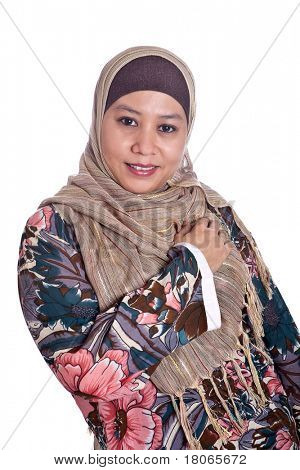 Confident Muslim woman in scarf, isolated
