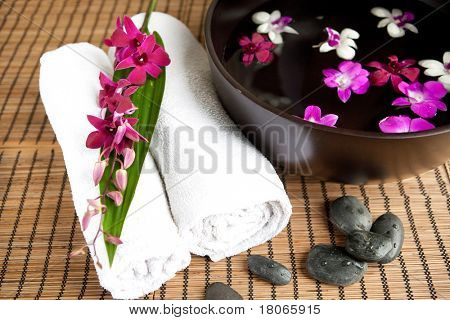 Spa therapy with orchids and hot stones