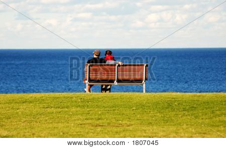 Couple Enjoying The Sea View