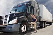 stock photo of big-rig  - Woman driver with her commercial 18-wheeler 