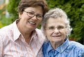 stock photo of elderly woman  - elderly woman with her daughter in the park - JPG