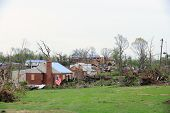 SAINT LOUIS, MISSOURI - APRIL 23: Damaged homes show tarp-covered roofs after tornadoes hit the Brid