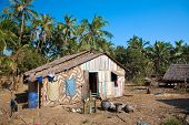 Traditional rural house made out of natural material on the poorer west coast of Ngwe Saung, Myanmar