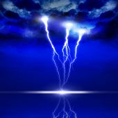 pic of lightning bolts  - image of lightning on a dark blue background - JPG