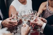People Toasting With Champagne And Wine Glasses In Hands Clinking At Luxury Wedding Reception At Res poster