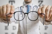 Oculist Doctor Is Offering Glasses To A Patient. Eye Sight Testi poster