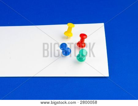 Push Pins On White Paper.