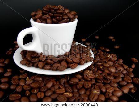 A Coffee Mug Full Of Coffee Beans