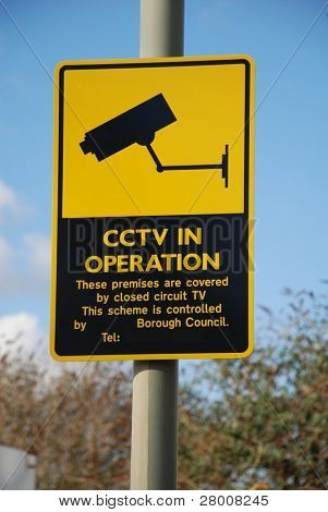 Signage warning of the use of CCTV cameras, in Ashford, Kent, England.