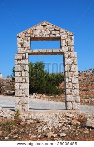 Stone doorway at the entrance to the five a side football stadium at Emborio on the Greek island of Halki.
