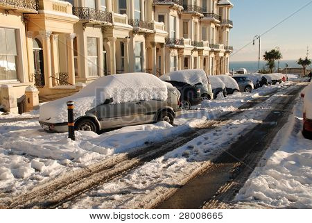 ST.LEONARDS-ON-SEA, ENGLAND - DECEMBER 3: Snow covers the road and cars in Warrior Square on December 3, 2010 at St.Leonards-on-Sea, East Sussex. It is the coldest Winter for 100 years in Britain.