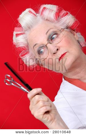 Old woman with her hair in rollers