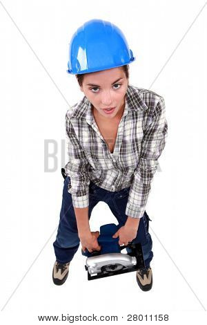 Woman laborer carrying heavy sander