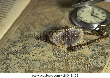 old map, watch and druze