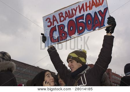 Russia, Moscow - December 24: Young Man And A Girl With Poster About Freedom.the Biggest Protest In