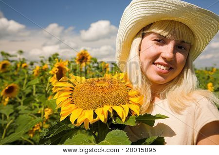 freckle? yuong woman in white hat with sunflower