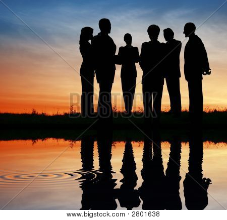 Silhouette Business Team. Sunset Water