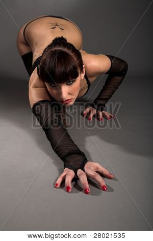 young beauty brunette isolated on gray