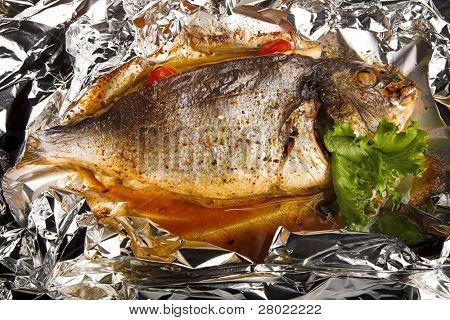 fried fish with tomato in foil