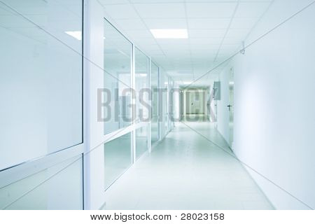 Long bright corridor in scientific laboratory building.