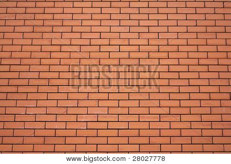 Wall ideally laid out by red bricks in a cathedral in Madrid
