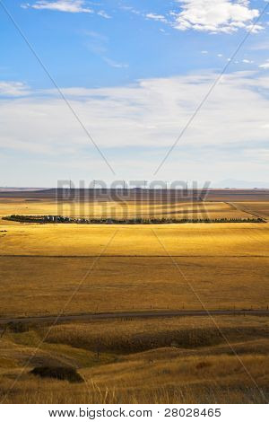 The American prairie in October. The American road and wind-driven generators on horizon