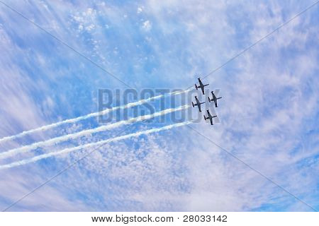 Four magnificent planes on air parade show art of synchronous flight