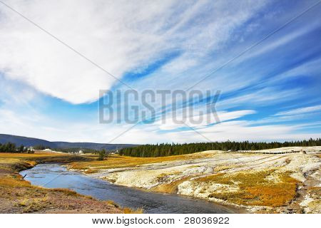 Flying clouds above meadows, woods  and river of the most well-known park in the world Yellowstone national park