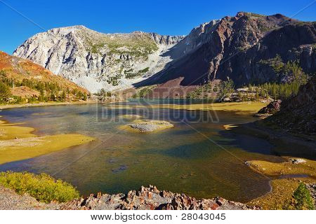 Picturesque shallow lake on pass Tioga in Yosemite park in the USA. Autumn midday