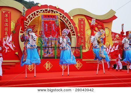 HONG KONG - JANUARY 24:  Beautiful dancers on stilts represent horsemen. Park Ocean. January 24, 2009, Hong Kong, China. Concert in the Chinese New Year