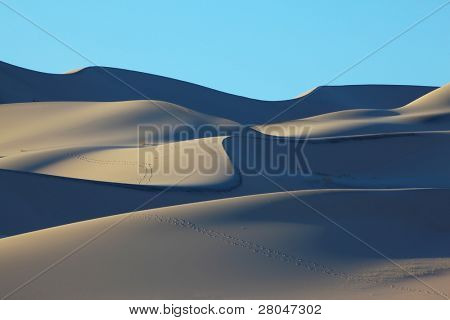 Cold blue shades on sand of a mysterious sandy dune Eureka