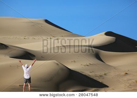 "The enthusiastic tourist welcomes sunrise. Erotic reminiscences in the sand ""waves"" Eureka Dunes"