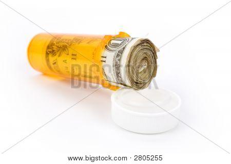 Medicine Pill Bottle And Dollar
