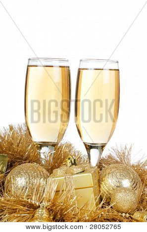 Champagne with Christmas ornaments isolated on white