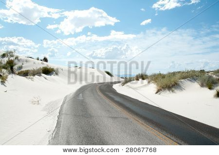 road through white sand dunes